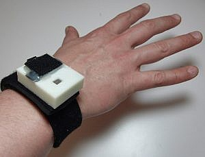 Neoprene wrist strap with ABS plastic shell containing the circuitry for measuring ozone concentration, PPG, motion, temperature, and humidity