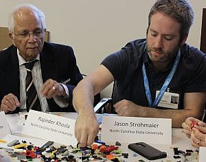 Dr. Rajinder Khosla, Senior Research Advisor at ASSIST, works on creative 'prototypes' of medical devices with Jason Strohmaier, Chief Systems Engineer, ASSIST