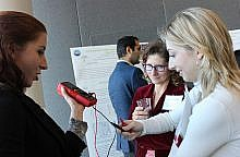 Amanda Myers, Graduate Research Assistant at ASSIST, demonstrates a prototype to Anita Watkins, Chair of the Industry Advisory Board, and Alex Obiol, Park Scholar Class of 2022